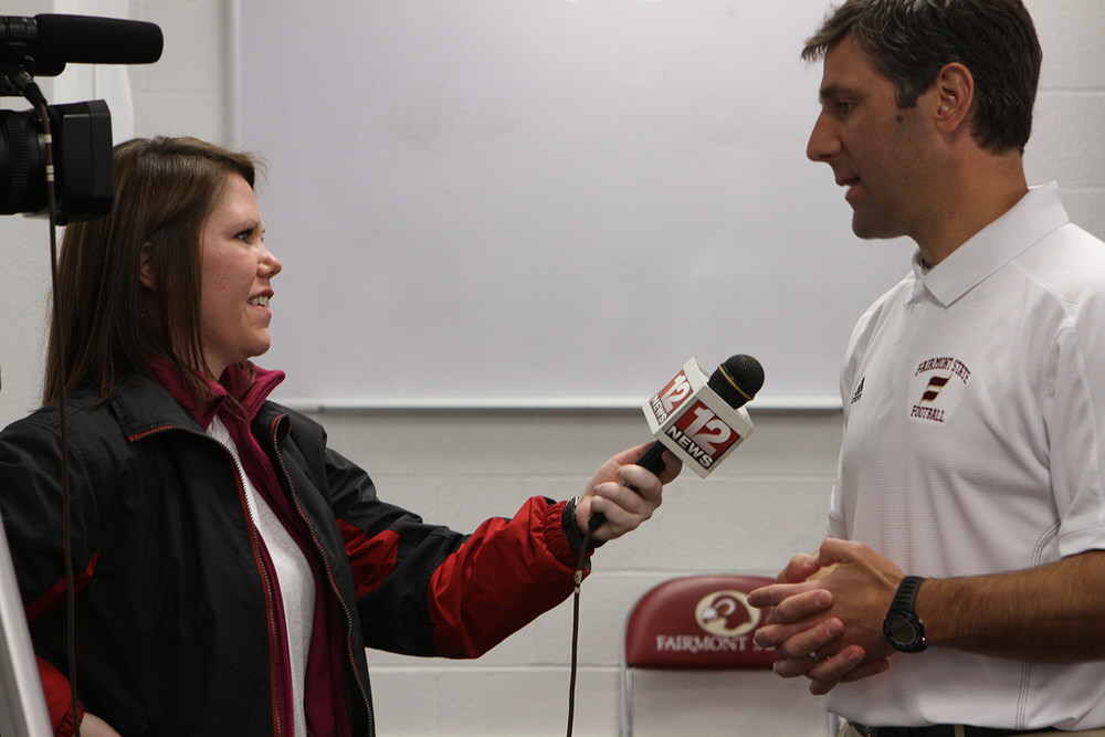 After the ribbon cutting ceremony, Katie Smith of WBOY interviews Head Coach Mik