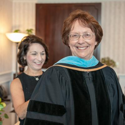 Dr. Christina Lavorata, Provost and Vice President for Academic Affairs, helps P